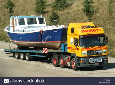 driving boat on trailer boat on low loader articulated trailer and hgv lorry