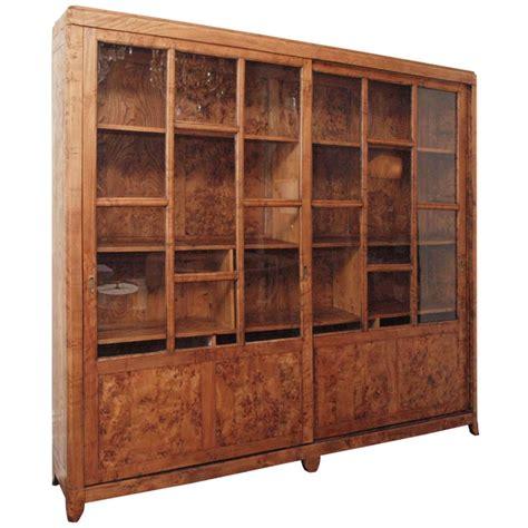 impressive burlwood glass front cabinet