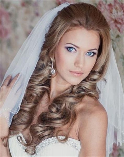 hairstyles down under half up half down wedding hairstyle with loose bouncy