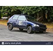 Old Peugeot 106 Rally Car Taking A Curve On 3 Wheels Stock