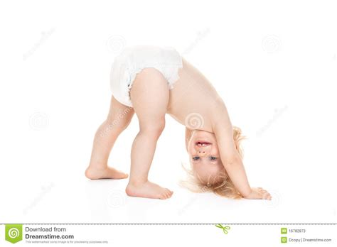 a small child in a nappy plays with the lock to a beach hut on the cute baby animals hugging hot girls wallpaper
