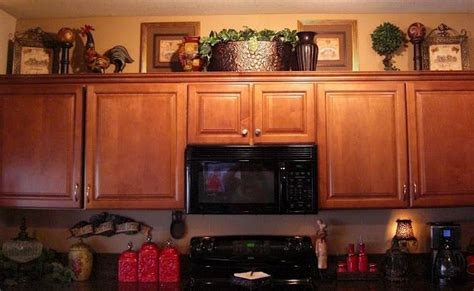 ideas for tops of kitchen cabinets ideas for decorating ontop of kitchen cabinets home