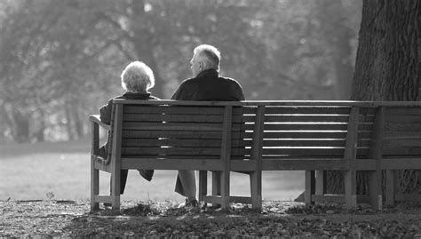 couple on park bench whiteofmyeyes perhaps it is and maybe it isn t