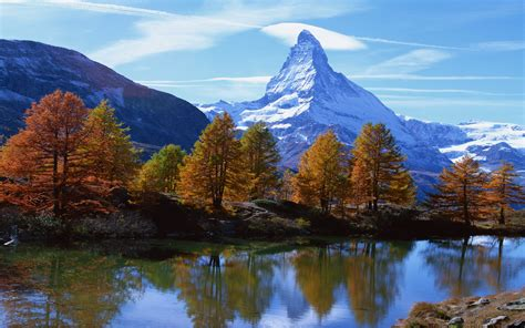 landscape mountain rocky alpine peak  snow autumn