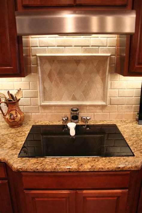 santa cecilia granite with light travertine tile