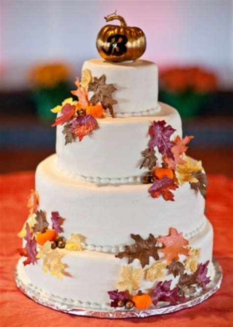 autumn theme 4 tier wedding cake with fall foliage and copper pumpkin monogram topper jpg