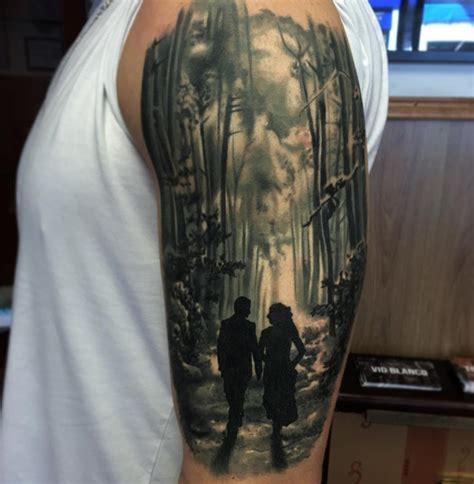 couple in the forest best tattoo design ideas