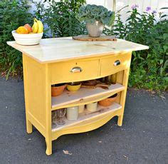 heir and space tables as kitchen islands old dresser turned into a space saving window seat bench