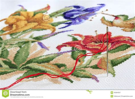 colorful stitches embroidery needle and thread with cross stitch in