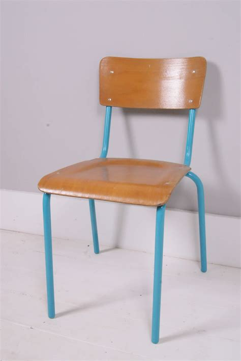 children s vintage wooden chair with turquoise metal legs