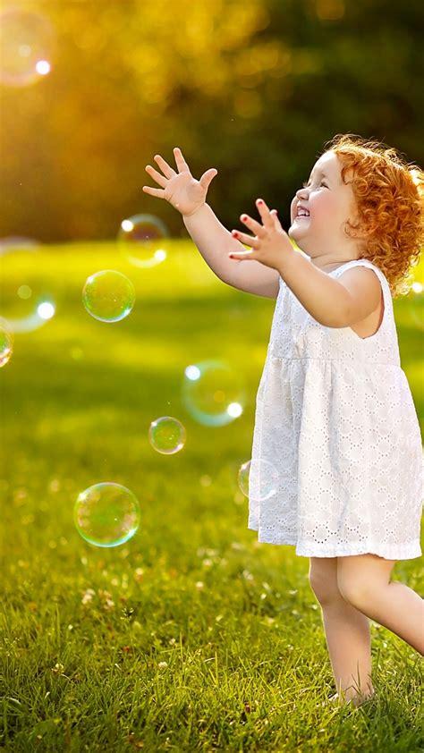 wallpaper cute girl playing bubbles meadow hd cute