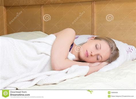 woman sleeping in bed young beautiful woman sleeping in bed stock photo image