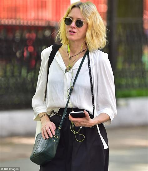Watts Blouse watts wears white blouse and black midi skirt while