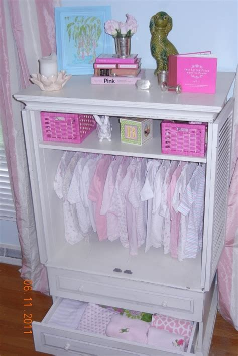 armoire for baby nursery tension rod in a armoire neat o household stuff