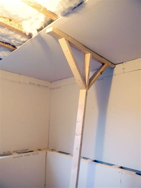 holding up sheet rock for finishing a ceiling diy home