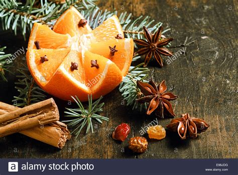 festive christmas background with a fresh orange cut in a