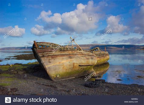 old boat wrecks old wooden fishing boat wrecks on mull stock photo