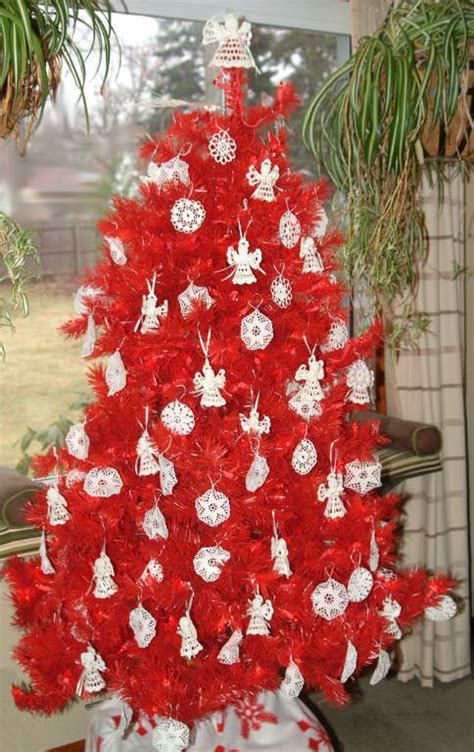 picture of a christmas tree with a red scarf aroud the top lipstick artificial tree treetopia