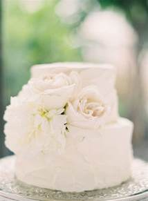 white 2 tier wedding cake small white two tier wedding cake decorated with some