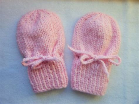 knitting pattern baby mittens thumbless pink thumbless mittens with strings knit of acrylic