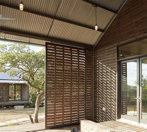 shutters for sliding glass patio doors lake flato porch house at miller ranch porch by lake