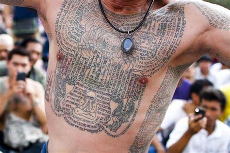 tattoo pain meditation tattoo festival thailand monks bless magic traditional