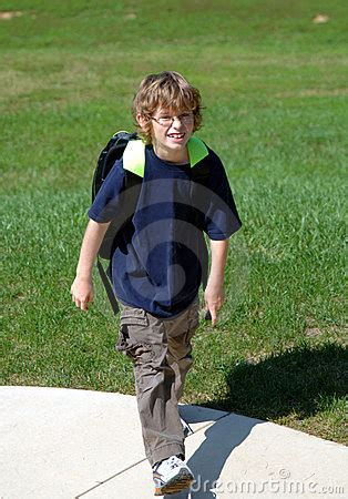 boy walking home from school stock photos image 6582173