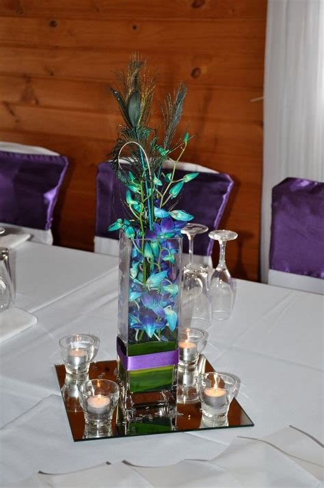 Singapore orchid & peacock feather wedding table