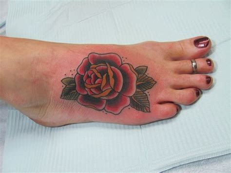rose tattoos on feet foot but in yellow tattoos