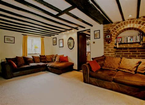 How to lighten a cottage with small windows and black wooden beams