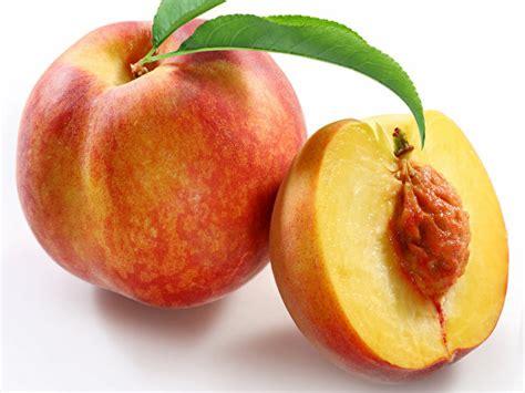 photo  peaches food closeup white background