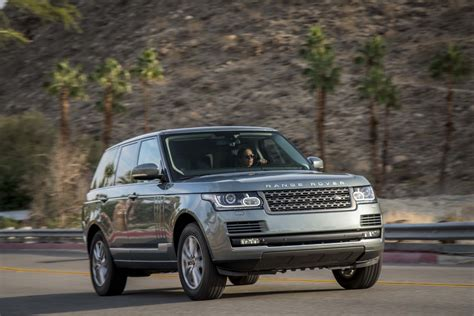 range rover in motion 2014 land rover range rover front three quarters in motion