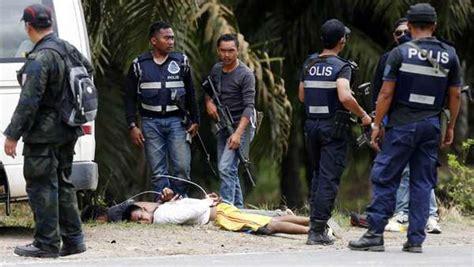 Lu Tembak Lapangan tentara sulu kehabisan makanan 52 tewas malaysia tolak
