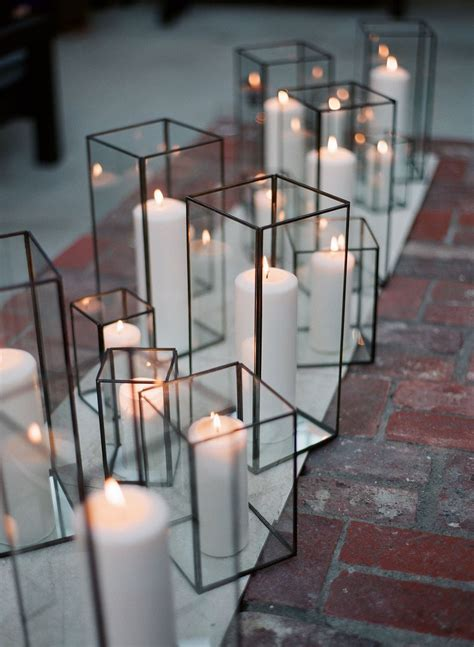white pillar candles in glass hurricanes, ceremony idea