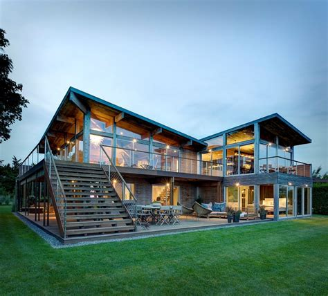 Earthy Timber Clad Interiors Vs Urban Glass Exteriors Cottage Design By Bates Masi