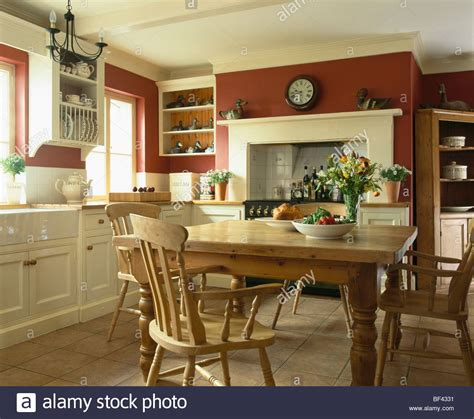 pine table and chairs in traditional country kitchen