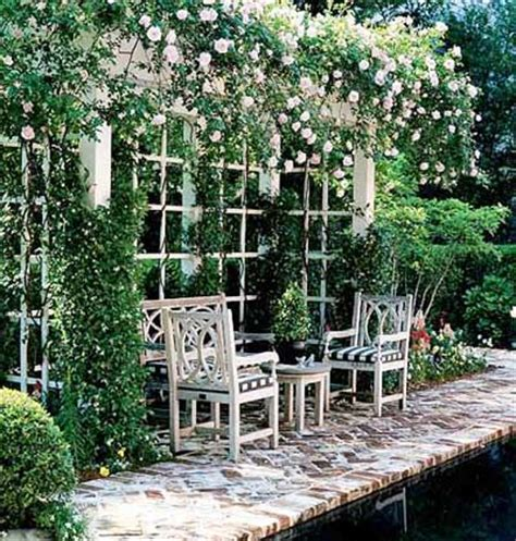 lacuna dei vasi secret garden a shallow pergola thick with roses and