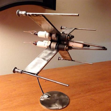 membuat kerajinan listrik kerennya miniatur pesawat dari busi bekas simulasi
