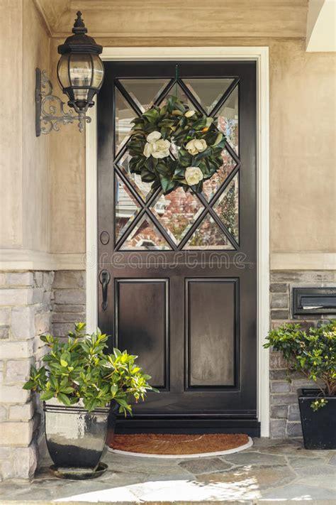 Black Front Door To Home With Flower Wreath Stock Image Front Door Light Timer