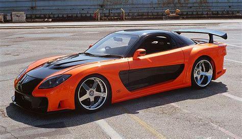 mazda rx7 orange and black mazda rx7