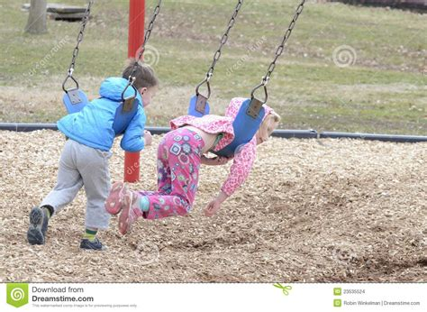 children on swing two children on swings stock images image 23535524