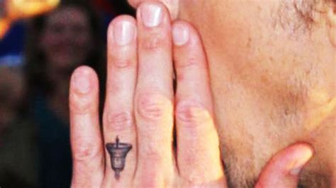 dax shepard tattoos dax shepard debuts bell on his ring finger to honor
