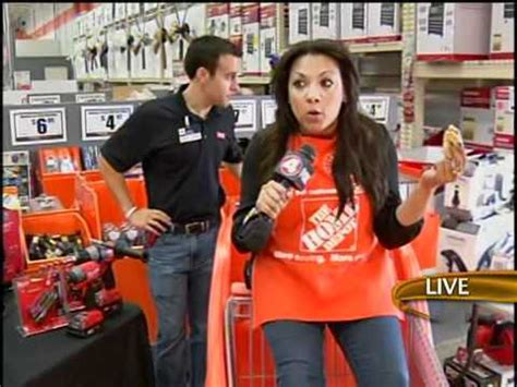 alex spray paints an employee at the home depot