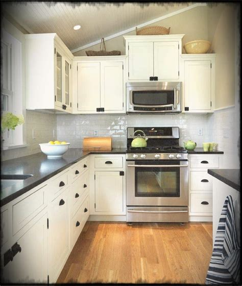 galley kitchen interior with l shaped layout feat black