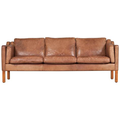 three seater sofa in camel coloured leather 1960s