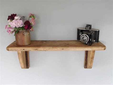 traditional wooden wall mounted shelf by seagirl