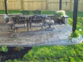 Navy Vases Backyard Patio With Poured Concrete Retaining Wall