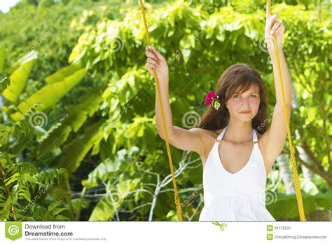 swinging naturals young beautiful woman swinging royalty free stock