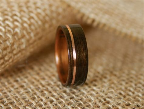 s wooden wedding band with 14k gold inlay in