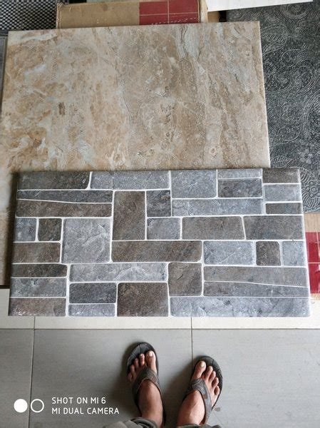 keramik dinding motif batu alam magna griss  icarus